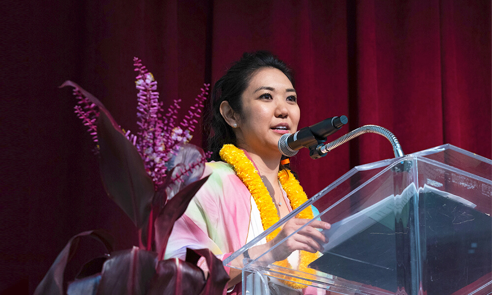 iQ 360's account director, Lynn Miyahira, giving her speech at the Hawaii United Okinawa Association Installation Banquet on Jan. 18, 2020, where she was recently appointed president of the Association.